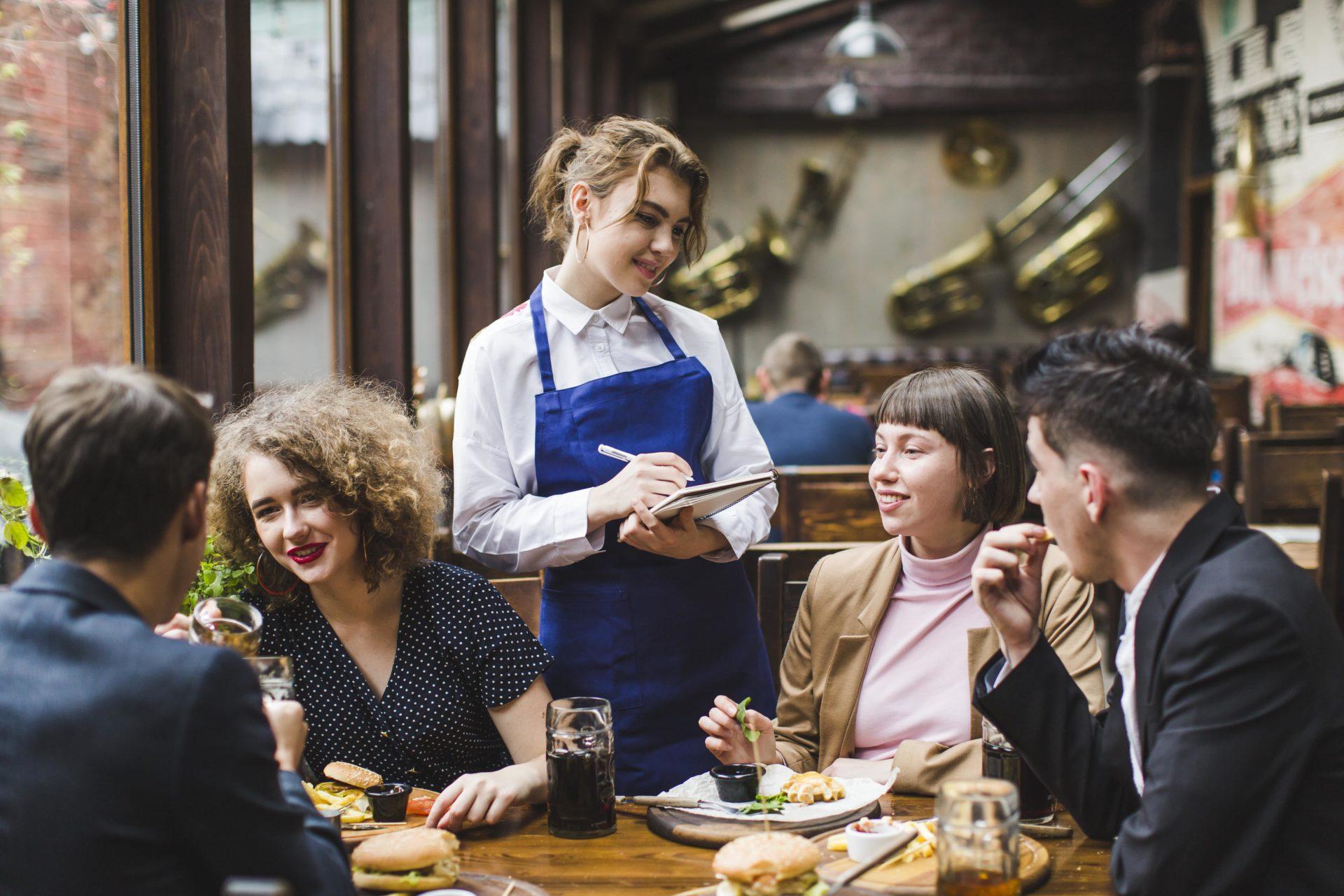 a waitress taking an order